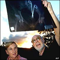 Pat and Don Skinner examine the X-ray