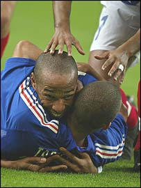 Thierry Henry and David Trezeguet celebrate a goal against Israel