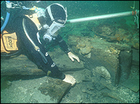 Diver inspecting wreck of the Swan