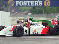 Senna waves the Brazilian flag after winning the 1993 Australian Grand Prix