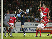 Saints' James Beattie (centre) just fails to hook the ball home