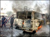 Burning minibus in Basra