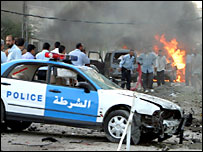 Iraqi police car at explosion scene