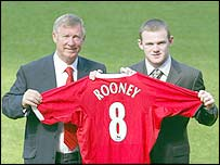 Sir Alex Ferguson with �27.5m signing Wayne Rooney