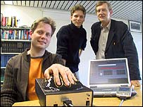 Carsten Wilks, Thomas Schieder,  Professor Rolf Eckmiller (left to right) with the tactile stimiulation unit