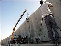 Men working on barrier