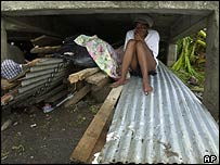 Woman shelters on Grenada during Hurricane Ivan
