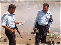 Iraqi police surveying scene of explosion