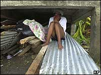 A woman takes shelter in Grenada
