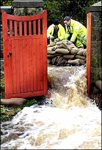 Water floods through a gate