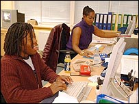Two black office workers
