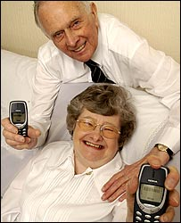 Photo of Pamela and Arthur Dee with their mobiles - courtesy of Tesco