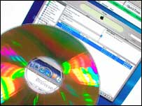 CD in front of music download page