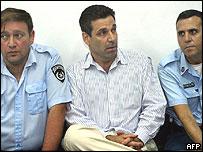 Israel's former Energy Minister Gonen Segev, centre, at the Tel Aviv district tribunal on Thursday, 22 April