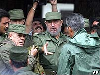 Cuban President Fidel Castro with civil defence officials in Pinar del Rio