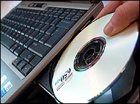Photo of blank CD and laptop