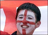 Man with face painted in England colours
