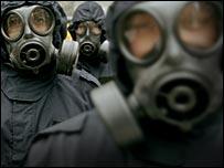 Policeman in gas masks