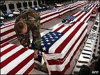 Undated photo of US military personnel offloading coffins of US soldiers killed in Iraq at Dover Air Base in Delaware