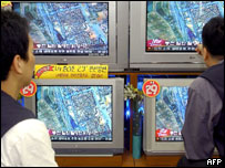 South Koreans watching TV footage of the blast area