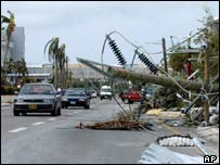 Power lines down across a street in Georgetown, Grand Cayman