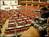 Photographers shoot the extraordinary session at the Turkish parliament
