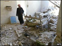 An Iraqi man in his destroyed home in Falluja