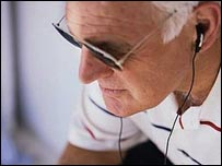 Old man using earphones