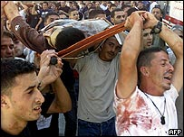 Palestinian mourners carry the body of a militant killed during an Israeli army raid in the West Bank city of Nablus 