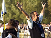 Europe captain Sam Torrance celebrates his side's victory in 2002