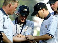 Garcia (2nd right) gives a good luck bracelet to Darren Clarke