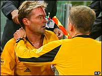 Referee Anders Frisk is struck on the head by a missile at Roma