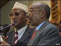 Shariff Hassan Sheikh Adan (right) takes his oath of office