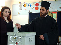 A Greek Orthodox priest votes in the village of Deftera near Nicosia