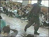 A hostage taker and children inside the school