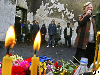 People mourn with candles