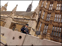 Armed police officer patrolling the Palace of Westminster