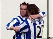 Kris Boyd (left) celebrates his opening goal against Hibs