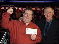 Pat Gibson is congratulated by host Chris Tarrant after winning the jackpot £1 million prize