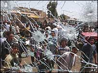 Bullet-marked windscreen of a bus in Baghdad