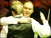 Paul Hunter hugs Matthew Stevens after their second-round match