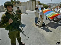 Israeli soldiers provide security as members of the Ecumenical Accompaniment Program in Palestine and Israel demonstrate against Madonna's visit to Rachel's tomb