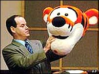 Lawyer Jeff Kaufmann holds up head of Tigger costume