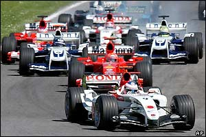 Jenson Button's BAR leads the field through the first corner