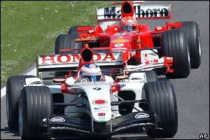 Jenson Button duels with Michael Schumacher