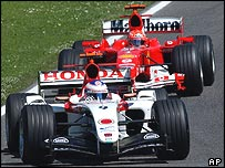 Michael Schumacher hounds Jenson Button in the early laps before moving away into a race of his own