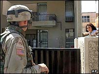 US soldier investigates Baghdad house