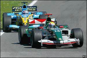Renault's Fernando Alonso prepares to lap Mark Webber's Jaguar