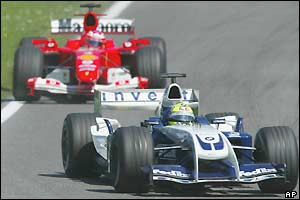 Rubens Barrichello's Ferrari chases the Williams of Ralf Schumacher