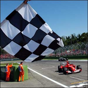 Michael Schumacher crosses the finishing line to win the San Marino Grand Prix
